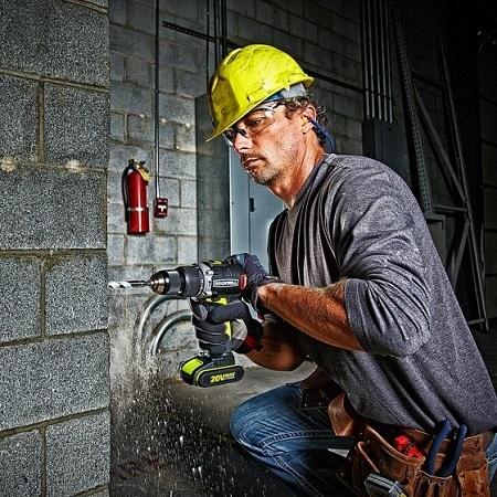 Man Using Cordless Hammer Drill